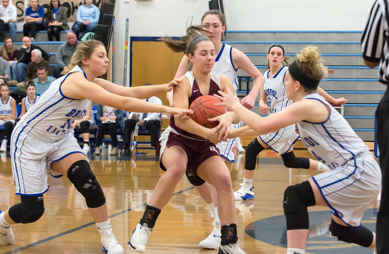 02/011/19  Wesley Bunnell | Staff  Bristol Eastern girls basketball held Senior Night on Monday evening before their game versus the visiting Bristol Central team. Gwen Torresso (20) is mobbed by Bristol Eastern defenders Meredith Forman (10), Julia Gettings (4) and Maura McGuire (30).