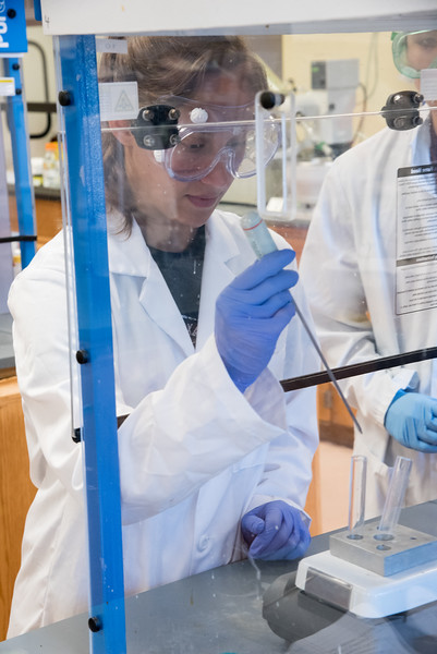 TAMUCC Student Amy Allen observer her findings during a trial run of her experiment.