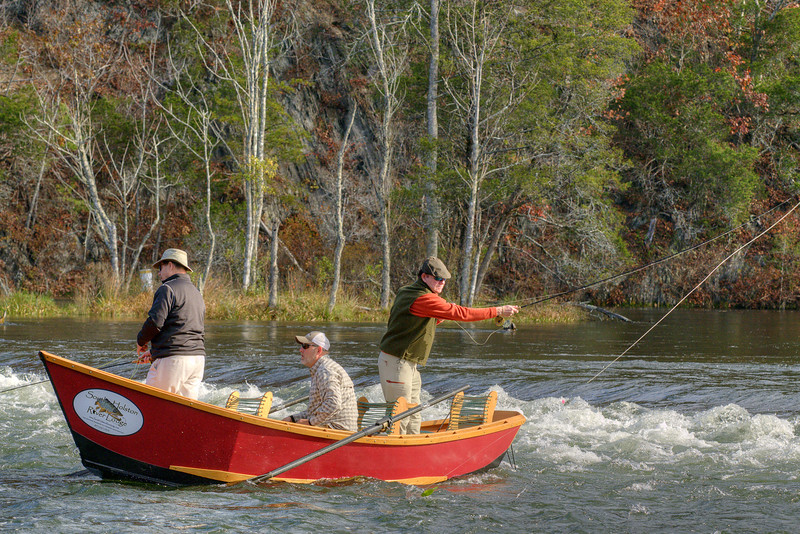 A group of men use a small row boat while fly fishing in the South Holston River south of the dam near Bristol, TN on Saturday, November 2, 2013. Copyright 2013 Jason Barnette