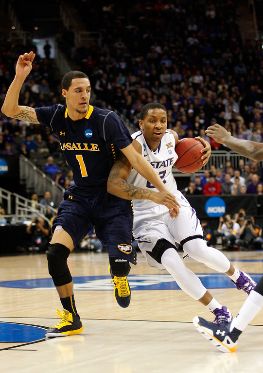 . KANSAS CITY, MO - MARCH 22: Rodney McGruder #22 of the Kansas State Wildcats drives against D.J. Peterson #1 of the La Salle Explorers in the first half during the second round of the 2013 NCAA Men\'s Basketball Tournament at the Sprint Center on March 22, 2013 in Kansas City, Missouri.  (Photo by Ed Zurga/Getty Images)