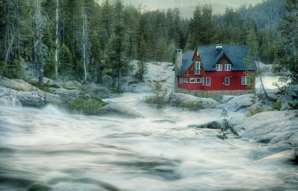 <h2>Red House On The Roaring River</h2> Winter 2010-11 kicked our butts. I know we weren't alone, but up here in the Sierra Nevadas, we had match-point record snowfall. At 50-60 feet depending on where you were standing, it didn't actually break all the records… but it was jawdropping all the same. And interminable. I mean, people tunneled down into their homes, okaayyy? I mention this because when you have record snowfall, it means record snowmelt too. This was the Yuba River near Big Bend on July 4th. Water level higher even than it was 2 weeks before… and so dangerous even the gnarliest kayakers were benched. This house had the best view… although I think if you lived there, you'd have gone deaf from the constant roar. Man, nature amazes me.