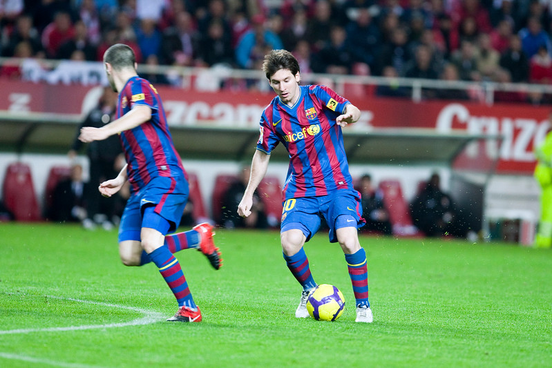 Messi with the ball before Iniesta. Spanish Cup game between Sevilla FC and FC Barcelona, Ramon Sanchez Pizjuan stadium, Seville, Spain, 13 January 2010