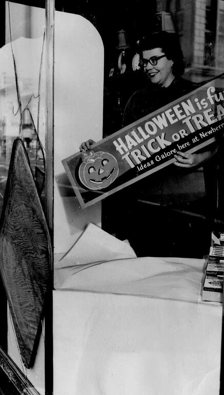 ". 1949: A Newberry\'s clerk displays an ironic sign and an inappropriate affect as she surveys a store window broken by ""pranksters\"" on Halloween night in downtown San Jose. \""More than a thousand youthful tricksters ... plagued police and provided spectators with a free show on First Street,\"" the caption says. (San Jose Mercury)"