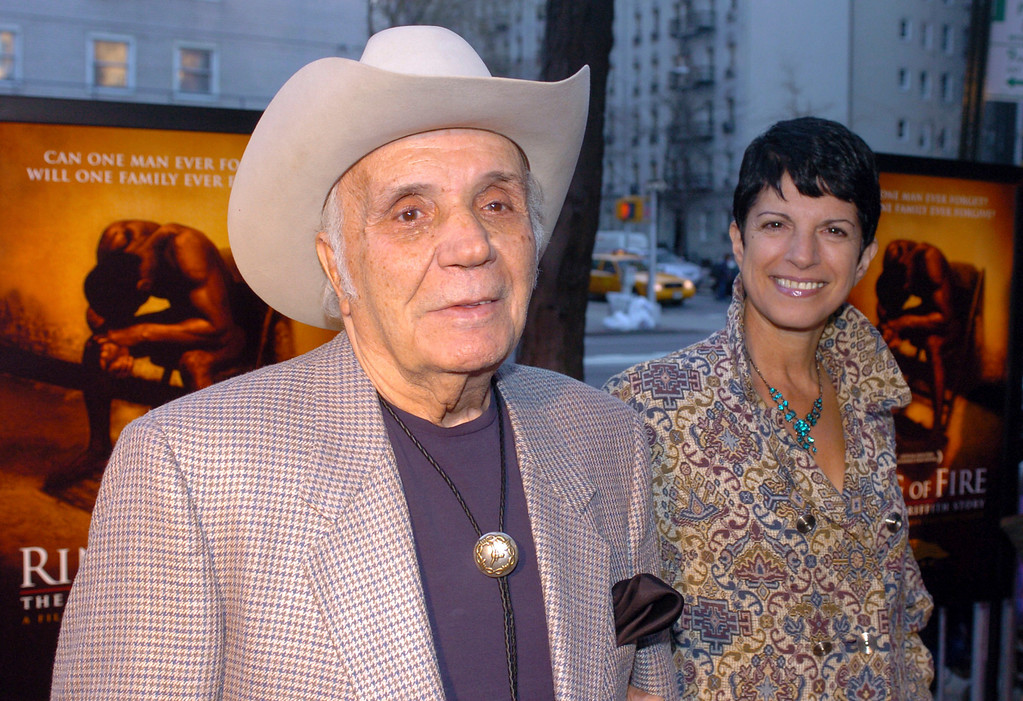 """. FILE - In this April 13, 2005, file photo, Jake LaMotta and his fiance Denise arrive for the world premier of the critically acclaimed boxing drama \""""Ring Of Fire: The Emile Griffith Story\"""" at the Beekman Theater in New York. LaMotta, whose life was depicted in the film �Raging Bull,� died Tuesday, Sept. 19, 2017, at a Miami-area hospital from complications of pneumonia. He was 95. (AP Photo/Gina Gayle, File)"""