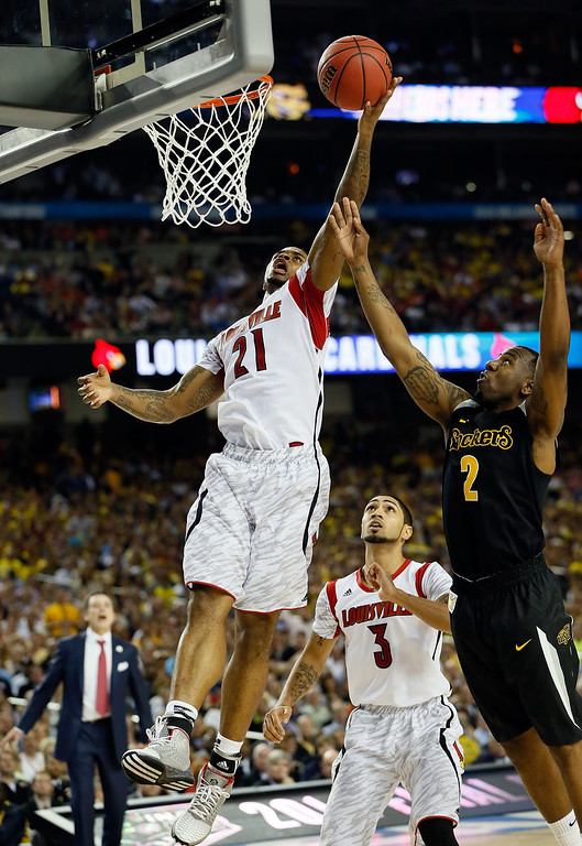 . ATLANTA, GA - APRIL 06:  Chane Behanan #21 of the Louisville Cardinals goes up for a shot against Malcolm Armstead #2 of the Wichita State Shockers in the second half during the 2013 NCAA Men\'s Final Four Semifinal at the Georgia Dome on April 6, 2013 in Atlanta, Georgia.  (Photo by Kevin C. Cox/Getty Images)