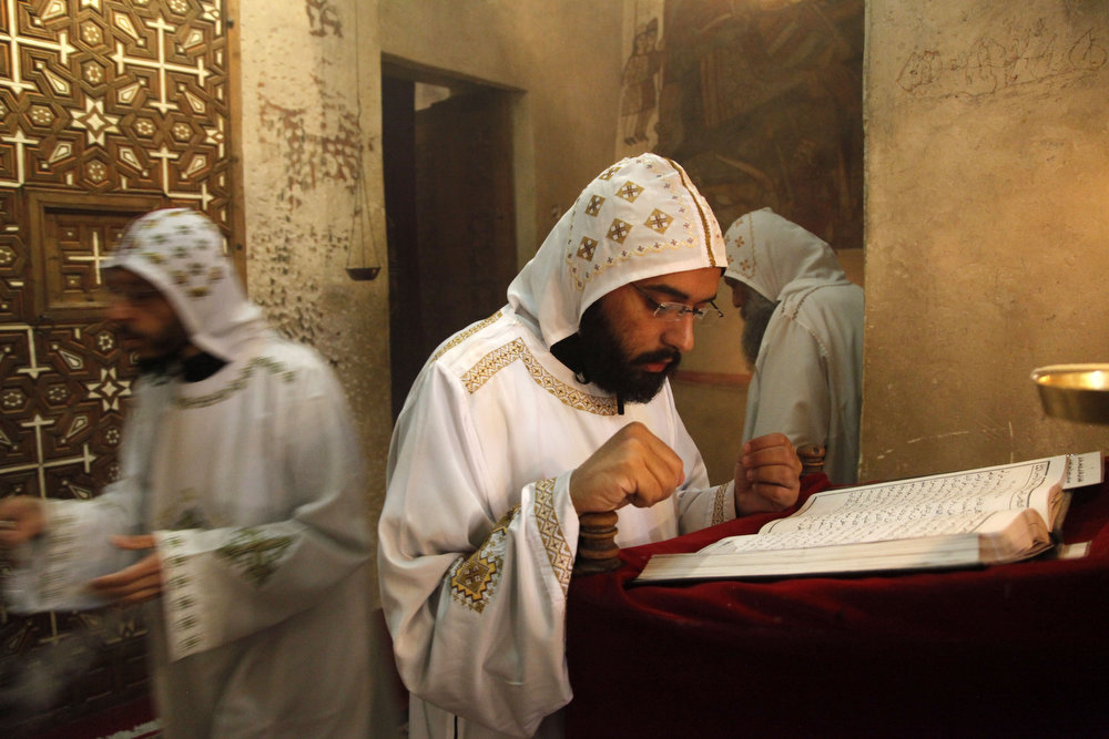 . Monks pray at the ancient monastery of St. Anthony in the eastern desert southeast of Cairo, Egypt on Tuesday, April 16, 2013. In a cave high in the desert mountains of eastern Egypt, the man said to be the father of monasticism took refuge from the temptations of the world some 17 centuries ago. The monks at the St. Anthony\'s Monastery bearing his name continue the ascetic tradition. But even they are not untouched by the turbulent times facing Egypt\'s Christians, defiantly vowing their community\'s voice won\'t be silenced amid Islamists\' rising power. (AP Photo/Manoocher Deghati)