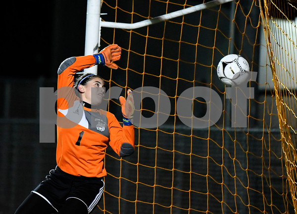11/14/2017 Mike Orazzi | Staff Old Lyme's Emily RIvera (1) gives up a goal to St. Paul's Briana Senese (38) during the Class S Semifinals Girls Soccer at Falcon Field in Meriden Tuesday night.