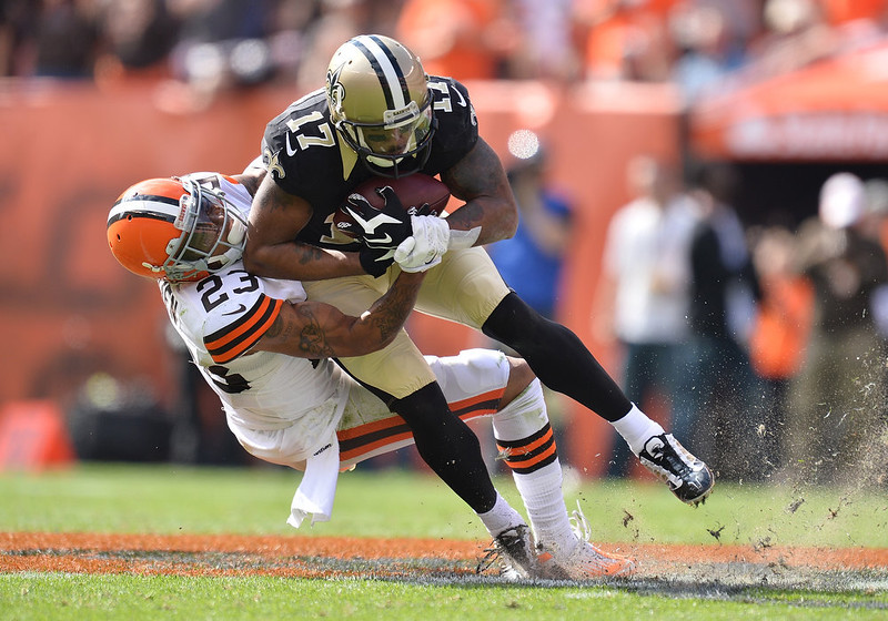 . Robert Meachem #17 of the New Orleans Saints gets tackled by Joe Haden #23 of the Cleveland Browns during the fourth quarter at FirstEnergy Stadium on September 14, 2014 in Cleveland, Ohio.  (Photo by Jamie Sabau/Getty Images)
