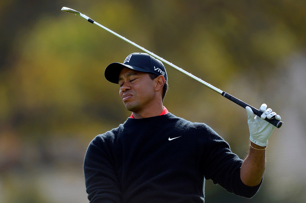 . Tiger Woods doesn\'t like his tee shot at the par 3 third hole during the final round of the Northwestern Mutual World Challenge golf tournament at Sherwood Country Club, Sunday December 8, 2013, in Thousand Oaks, Calif.(Andy Holzman/Los Angeles Daily News)