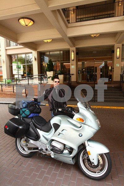A biker on a BMW motorcycle at the Holiday Inn in Vancouver, British Columbia.