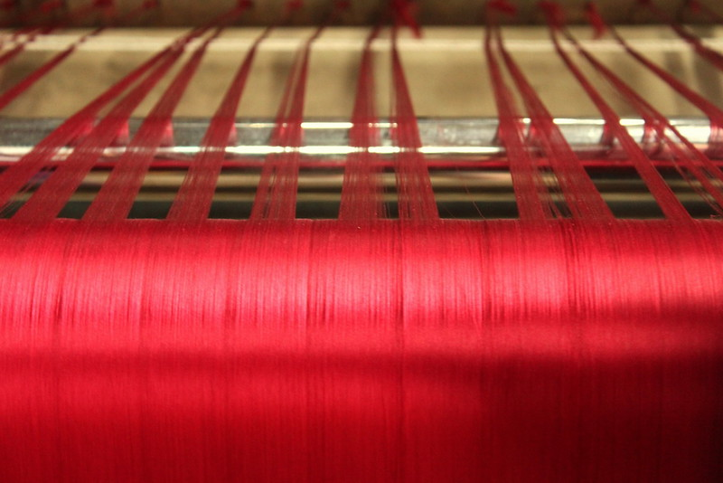 Died silk being made into larger threads