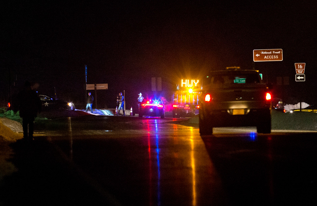 . Highway 395 is blocked at Seneca between John Day and Burns, Ore., by Oregon State police officers the evening of Tuesday, Jan. 26, 2016. A more than 50-mile stretch of highway in Oregon has been closed near where an armed group has been occupying a national wildlife refuge. A group led by Ammon Bundy seized the headquarters of the Malheur National Wildlife Refuge south of Burns on Jan. 2 as part of a long-running dispute over public lands in the West.  (Dave Killen/The Oregonian via AP)