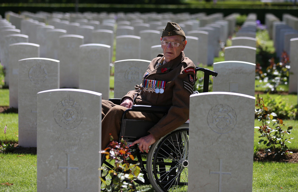 . Normandy veteran, Ken Scott 98, who was an infantry sergeant with the Durham Light Infantry on Gold Beach on D-Day looks at headstones in the cemetery following a service at Bayeux Cemetary during D-Day 70th anniversary commemorations on June 6, 2014 in Bayeux, France.  (Photo by Matt Cardy/Getty Images)