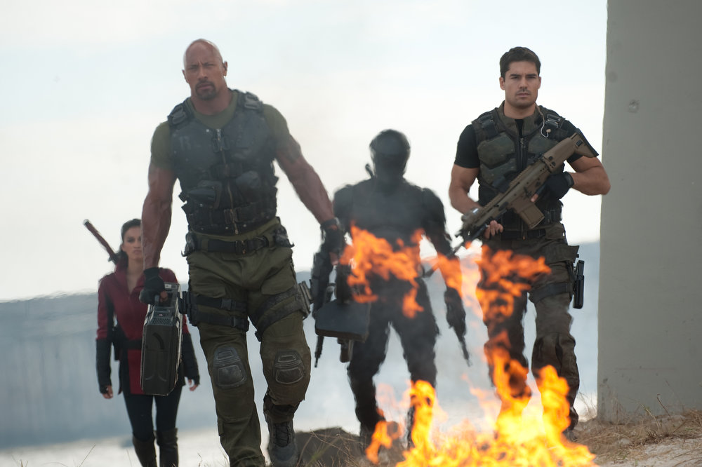. Left to right: Elodie Yung plays Jinx, Dwayne Johnson plays Roadblock, Ray Park plays Snake Eyes, and D.J. Cotrona plays Flint in G.I. JOE: RETALIATION, from Paramount Pictures, MGM, and Skydance Productions. (Jaimie Trueblood/Paramount Pictures)