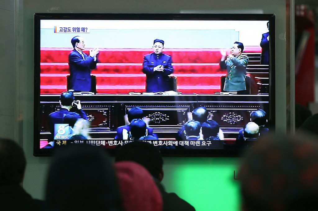 """. People watch a TV news report showing North Korean leader Kim Jong Un, center, and other leaders, at Seoul Railway Station in Seoul, South Korea, Saturday, March 30, 2013. North Korea warned Seoul on Saturday that the Korean Peninsula was entering \""""a state of war\"""" and threatened to shut down a factory complex that\'s the last major symbol of inter-Korean cooperation.(AP Photo/Ahn Young-joon)"""