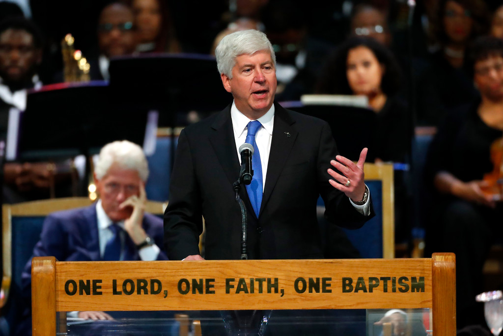 . Michigan Gov. Rick Snyder speaks during the funeral service for Aretha Franklin at Greater Grace Temple, Friday, Aug. 31, 2018, in Detroit. Franklin died Aug. 16, 2018 of pancreatic cancer at the age of 76. (AP Photo/Paul Sancya)