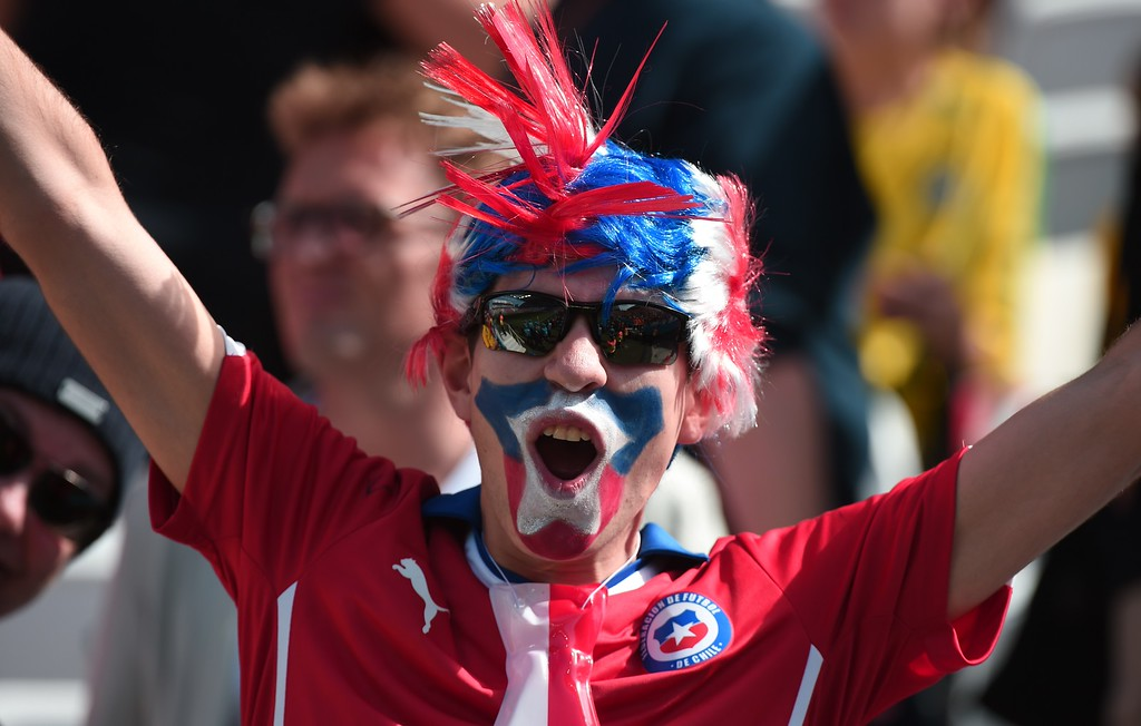 . Chile fans cheer prior to the Group B football match between Netherlands and Chile at the Corinthians Arena in Sao Paulo during the 2014 FIFA World Cup on June 23, 2014. AFP PHOTO / DAMIEN  MEYER/AFP/Getty Images