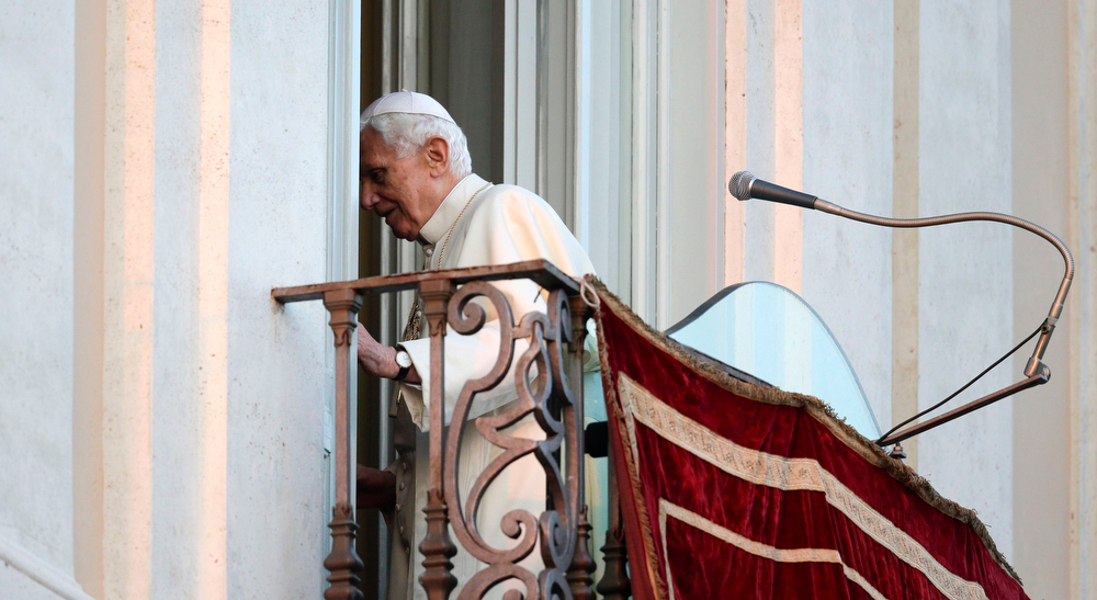 . Pope Benedict XVI leaves as he appears for the last time at the balcony of his summer residence in Castelgandolfo, south of Rome, February 28, 2013.  REUTERS/Max Rossi