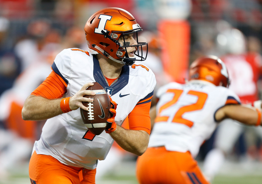 . Illinois quarterback Chayce Crouch drops back to pass against Ohio State during the first half of an NCAA college football game Saturday, Nov. 18, 2017, in Columbus, Ohio. (AP Photo/Jay LaPrete)