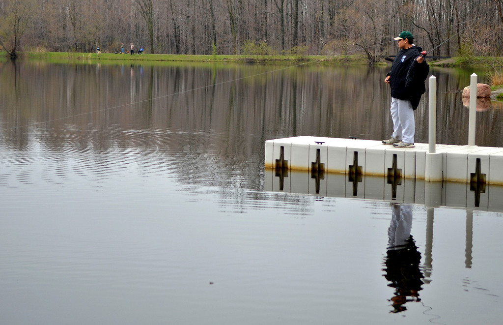 . Jeff Forman/JForman@News-Herald.com Marcus Manzi, of Willoughby, casts his line during the Lake Metroparks Fantastic Fishing program for people with disabilities April 30 at Hidden Lake in Leroy Township.
