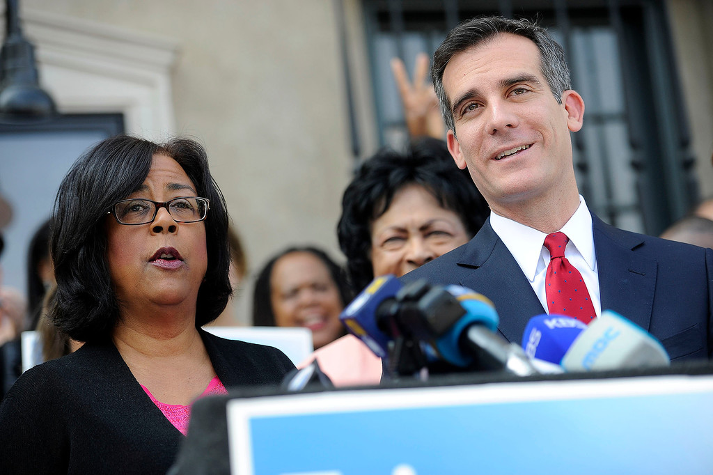 . Jan Perry and Eric Garcetti during a press conference to to announce Perry\'s endorsement for Mayor at the 28th Street YMAC in South Los Angeles Thursday, March 28, 2013. (Hans Gutknecht/Staff Photographer)