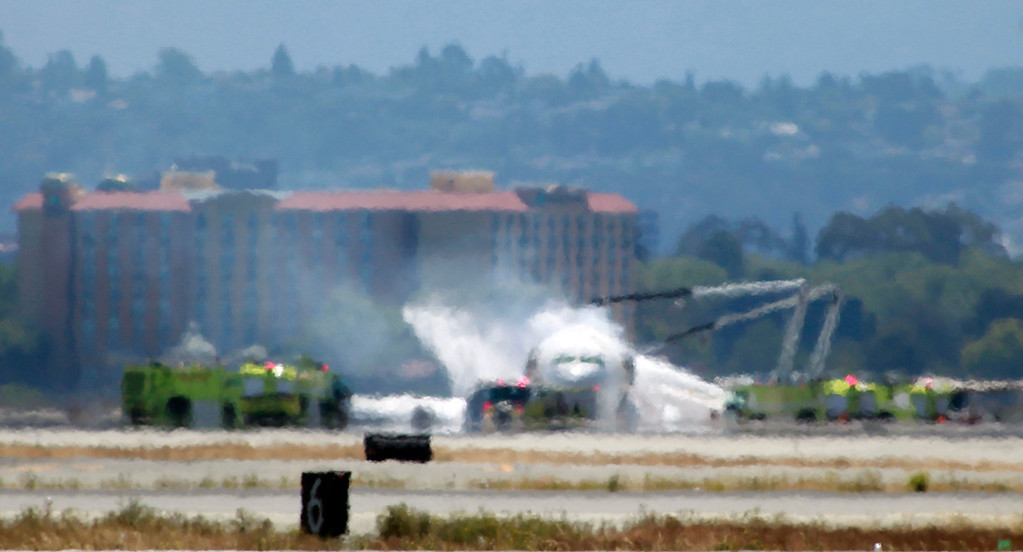 . Firefighters spray foam on an Asiana Airlines Boeing 777 that crashed at San Francisco International Airport near Milbrae, Calif., Saturday afternoon July 6, 2013.  (Karl Mondon/Bay Area News Group)