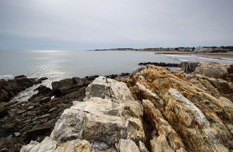 rocky coastline and shimmering water, along the New Hampshire coast