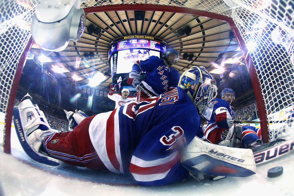 . Henrik Lundqvist #30 and Chris Kreider #20 of the New York Rangers watches Daniel Briere #48 of the Montreal Canadiens (not pictured) goal into the back of the net in Game Three of the Eastern Conference Final during the 2014 NHL Stanley Cup Playoffs at Madison Square Garden on May 22, 2014 in New York City.  (Photo by Al Bello/Getty Images)