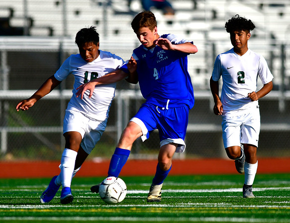 10/1/2019 Mike Orazzi   StaffrBristol Eastern's Tyler Borry (4) during boys soccer with Maloney at BEHS Tuesday.