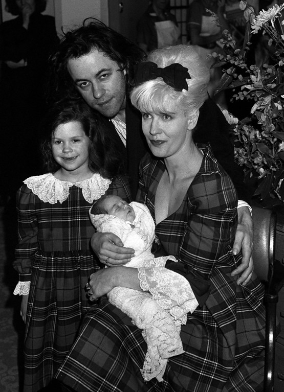 . In this March 16, 1989 file photo rock star Bob Geldof, his wife, TV presenter Paula Yates, right, and their five-year-old daughter Fifi Trixiebelle, left, show off the new addition to their family, an as yet unnamed baby girl, later named Peaches, at St Mary\'s Hospital in Paddington, London. (AP Photo/PA, Martin Keene, File)