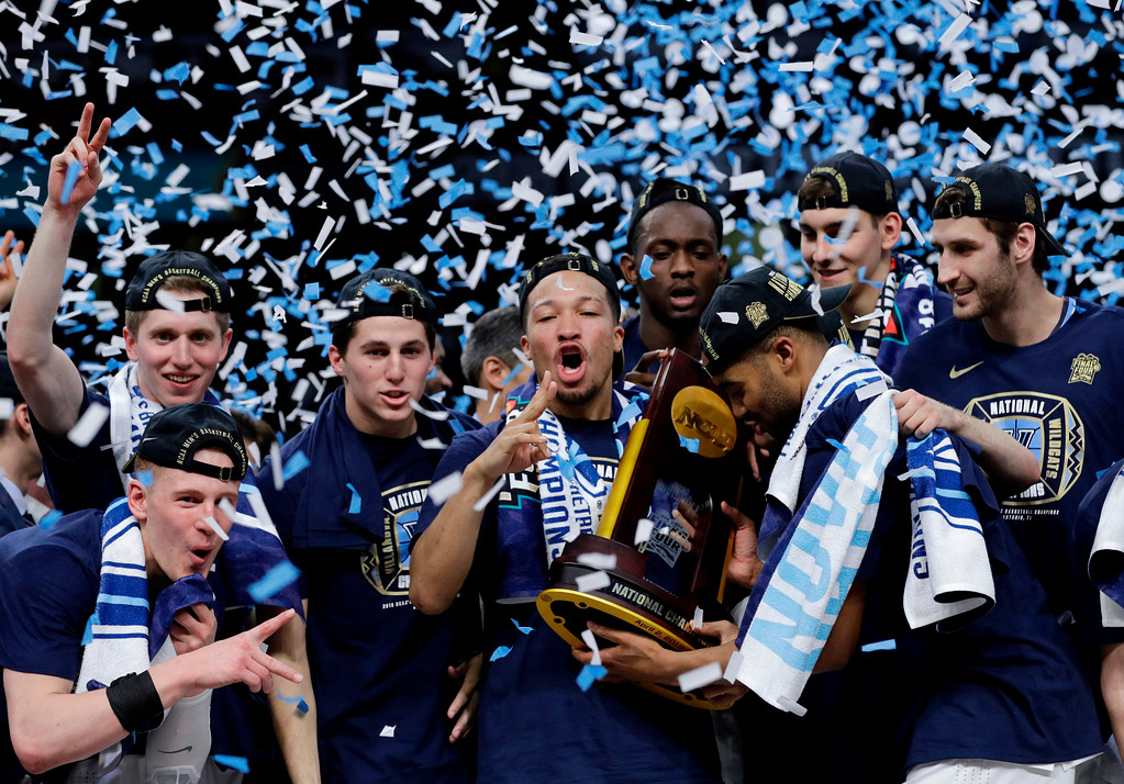 . Villanova players celebrate with the trophy after beating Michigan 79-62 in the championship game of the Final Four NCAA college basketball tournament, Monday, April 2, 2018, in San Antonio. (AP Photo/David J. Phillip)
