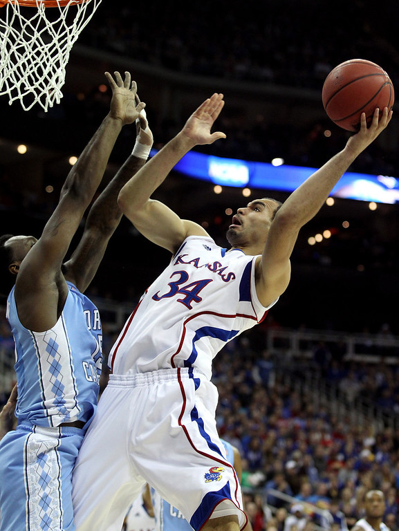 . Perry Ellis #34 of the Kansas Jayhawks attempts a shot in the first half against the North Carolina Tar Heels during the third round of the 2013 NCAA Men\'s Basketball Tournament at Sprint Center on March 24, 2013 in Kansas City, Missouri.  (Photo by Ed Zurga/Getty Images)