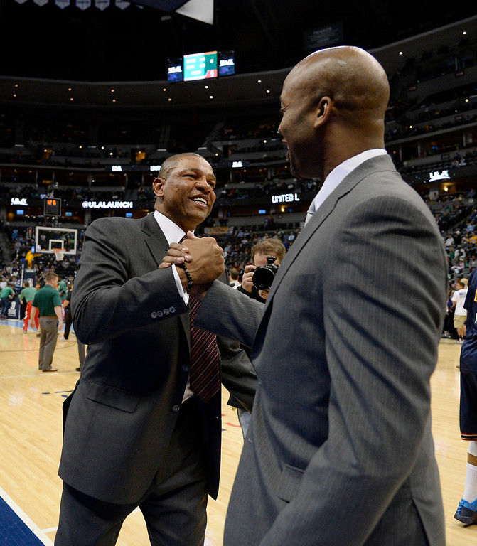 . Denver Nuggets head coach Brian Shaw shakes hand with Los Angeles Clippers head coach Doc Rivers before their game March 17, 2014 at the Pepsi Center. (Photo by John Leyba/The Denver Post)