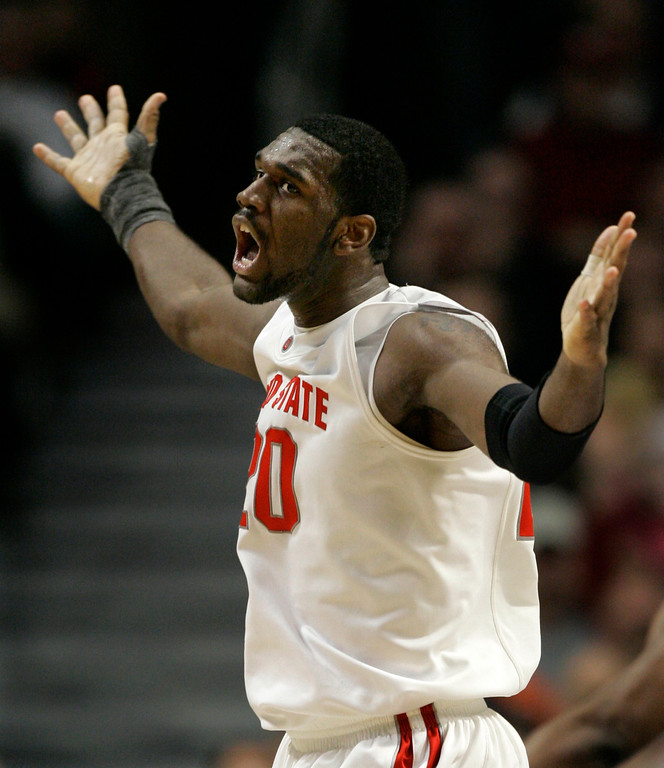 . Ohio State center Greg Oden reacts after dunking the ball during the second half of their Big Ten Tournament basketball semifinal game against Purdue in Chicago, Saturday, March 10, 2007. Ohio State defeated Purdue 63-52. (AP Photo/Brian Kersey)