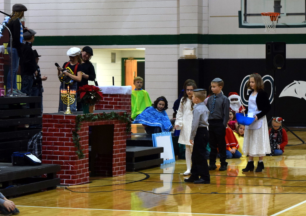 """. Students collect ingredients to make latkes during Fleming Elementary\'s second through fourth grade production of \""""Once on a Housetop\"""" Monday, Dec. 11, 2017."""