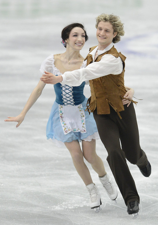 . Meryl Davis and Charlie White of USA skate in the Ice Dance Short Dance during day one of the ISU Four Continents Figure Skating Championships at Osaka Municipal Central Gymnasium on February 8, 2013 in Osaka, Japan.  (Photo by Atsushi Tomura/Getty Images)