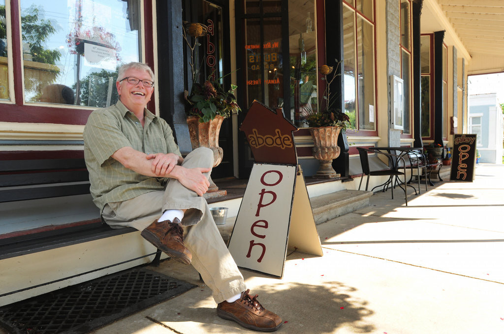 . Allen Nugent, owner of Abode Gallery, sits outside his shop on Wednesday, June 27, 2013 in Stockholm. Nugent  offers an interior design service in addition to home furnishings, jewelry, decorative and functional art and fiber art. (Pioneer Press: Ginger Pinson)