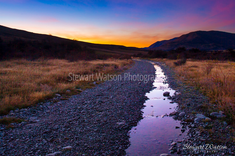 The stunning colours in the sky of an Ashburton high country valley sunrise