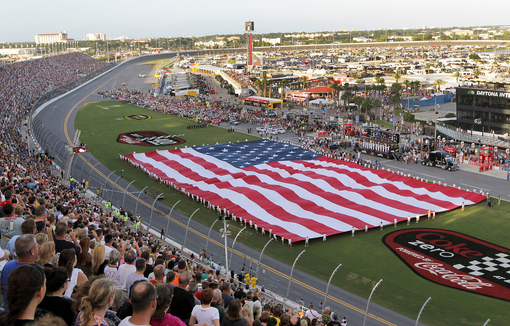 . A giant U.S. is displayed in the infield during pre-race activities for the NASCAR Sprint Cup auto race at Daytona International Speedway, Saturday, July 6, 2013, in Daytona Beach, Fla. (AP Photo/David Graham)