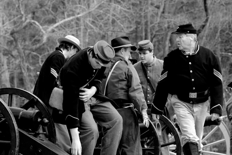 After taking the hill, Union reenactors turn the canons around to face the remaining Confederate reenactors. The Skirmish at Gamble's Hotel happened on March 5, 1885 when 500 federal soldiers, under the command of Reuben Williams of the 12th Indiana Infantry, marched into Florence to destroy the railroad depot but were met by Confederate soldiers backed up with 400 militia. The reenactment, held by the 23rd South Carolina Infantry, was held at the Rankin Plantation in Florence, South Carolina on Saturday, March 5, 2011. Photo Copyright 2011 Jason Barnette