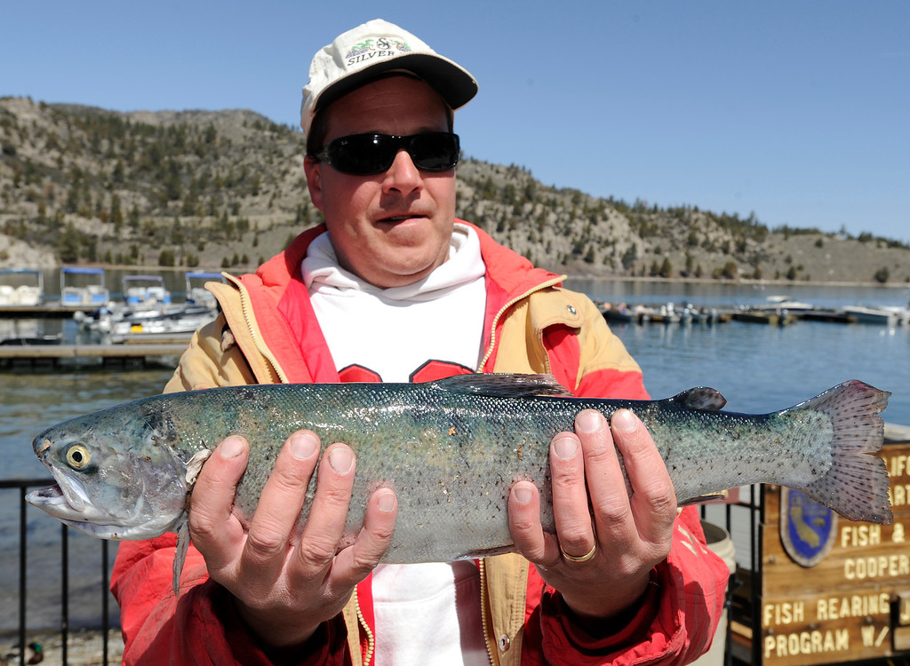 . Whit Behrens of Pleasant Hill, CA with the 3.9 pound rainbow he caught at June Lake on opening day of Trout Fishing Season in the Eastern Sierra. June Lake, CA 4/27/2013(John McCoy/Staff Photographer)
