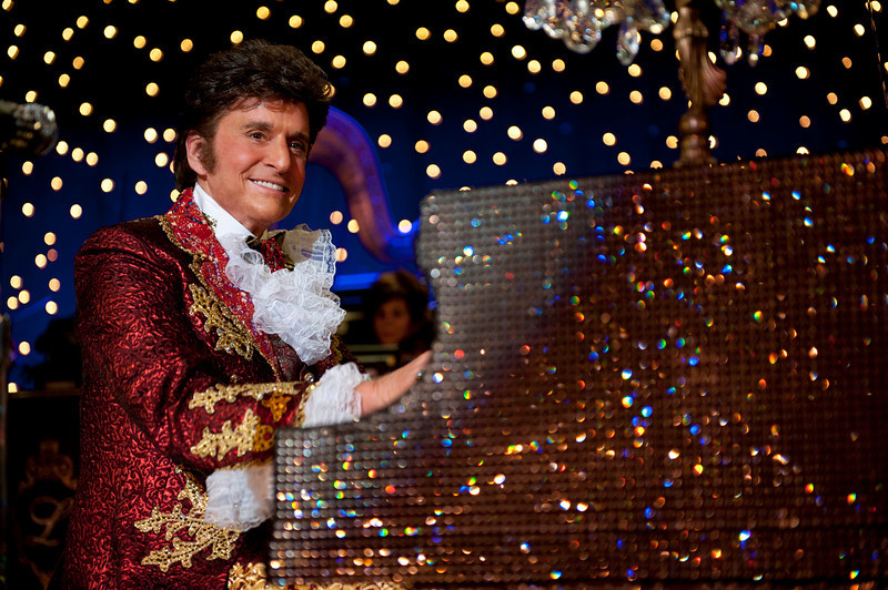 ". This film image released by HBO shows Michael Douglas as Liberace in a scene from ""Behind the Candelabra.\"" Douglas was nominated for an Emmy Award for best actor in a miniseries or movie on, Thursday July 18, 2013. The Academy of Television Arts & Sciences\' Emmy ceremony will be hosted by Neil Patrick Harris. It will air Sept. 22 on CBS. (AP Photo/HBO, Claudette Barius)"