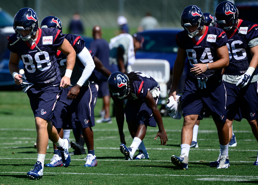 . CENTENNIAL, CO - AUGUST 19: The Houston Texans work through warm ups before the start of practice at Dove Valley. The Denver Broncos prepare at Dove Valley on Tuesday, Aug. 19, 2014 in Centennial for their upcoming game against the Houston Texans on Saturday, Aug. 23, 2014. (Photo by Kathryn Scott Osler/The Denver Post)
