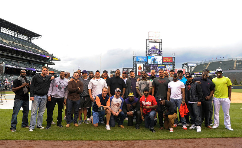 . Some of the Denver Broncos team pose for a photo during the Colorado Rockies New York Yankees batting practice May 7, 2013 at Coors Field. (Photo By John Leyba/The Denver Post)