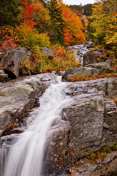 Flume Cascade on a golden Autumn day in Crawford Notch State Park