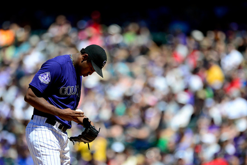 . Colorado Rockies starting pitcher Juan Nicasio (44) makes an adjustment against the San Diego Padres during the first inning in Denver. The Colorado Rockies hosted the San Diego Padres at Coors Field on Sunday, June 9, 2013. (Photo by AAron Ontiveroz/The Denver Post)