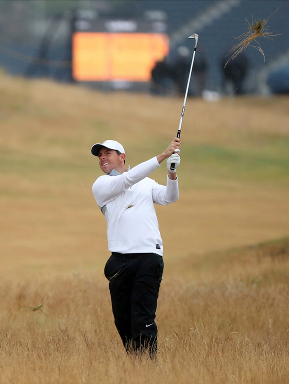 . Rory McIlroy of Northern Ireland plays out of the rough on the 4th hole during the second round of the British Open Golf Championship in Carnoustie, Scotland, Friday July 20, 2018. (AP Photo/Peter Morrison)