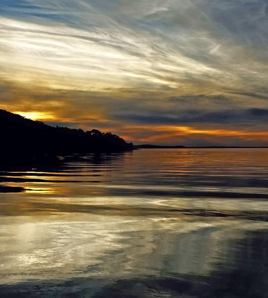 White coloured cirrus cloud, sunset seascape.