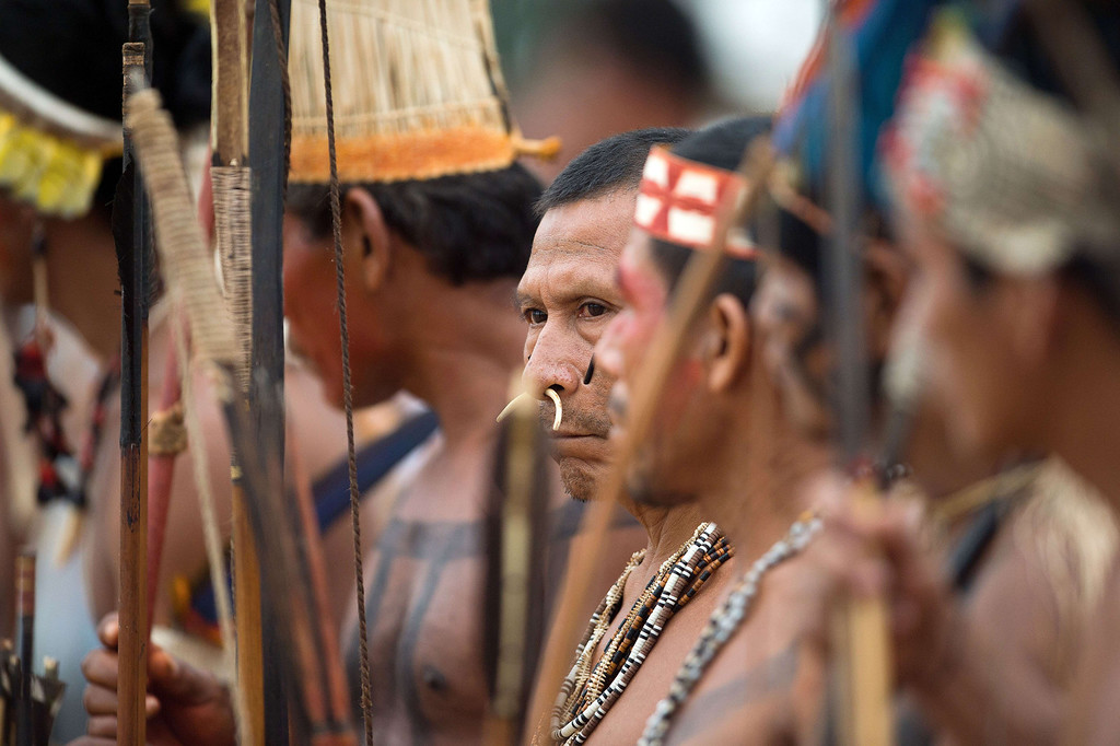 . A Brazilian indigenous man of the Matis tribe waits to take part in the bow and arrow competition during the XII International Games of Indigenous Peoples in Cuiaba, Mato Grosso state, Brazil on November 12, 2013. AFP PHOTO / Christophe SIMON/AFP/Getty Images