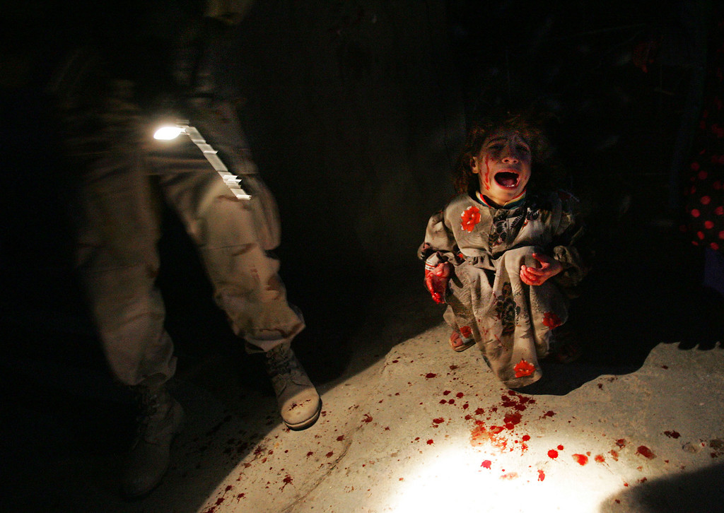 . Samar Hassan, 5, screams after her parents were killed by U.S. Soldiers with the 25th Infantry Division in a shooting January 18, 2005 in Tal Afar, Iraq. The troops fired on the Hassan family car when it unwittingly approached them during a dusk patrol in the tense northern Iraqi town. Parents Hussein and Camila Hassan were killed instantly, and a son Racan, 11, was seriously wounded in the abdomen. Racan, paralyzed from the waist down, was treated later in the U.S. (Photo by Chris Hondros/Getty Images)